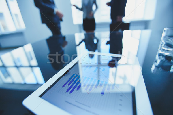 Document in touchpad Stock photo © pressmaster