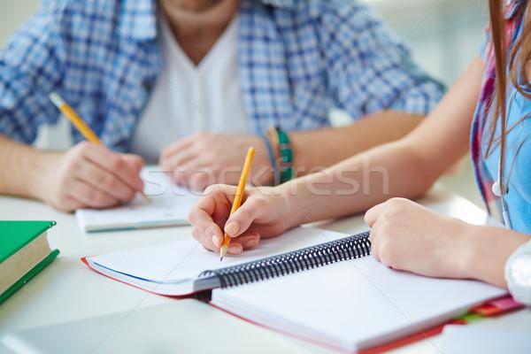 Oktatás kéz diák toll hordoz ki Stock fotó © pressmaster
