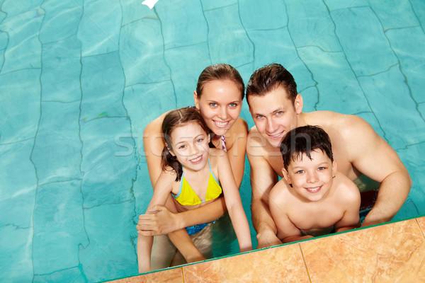 семьи воды фото счастливая семья Бассейн улыбаясь Сток-фото © pressmaster