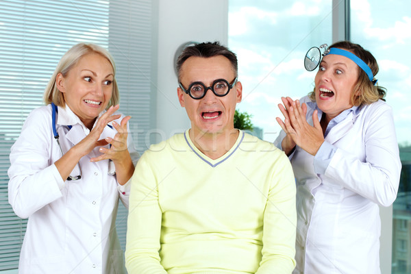 Scary entusiasmo ritratto paziente paura medici Foto d'archivio © pressmaster