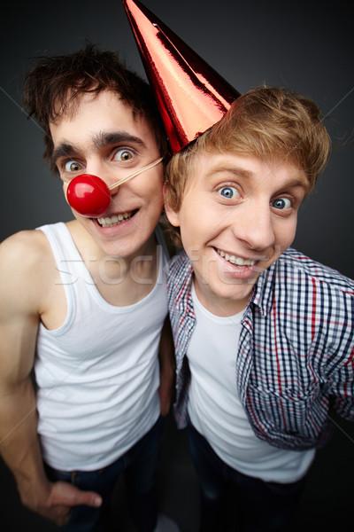 Dois engraçado caras olhando câmera sorridente Foto stock © pressmaster