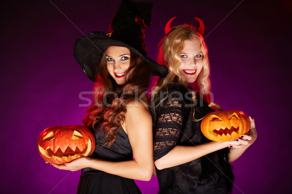 Females with pumpkins Stock photo © pressmaster