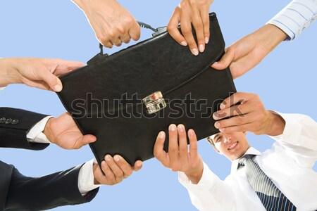 Holding briefcase Stock photo © pressmaster