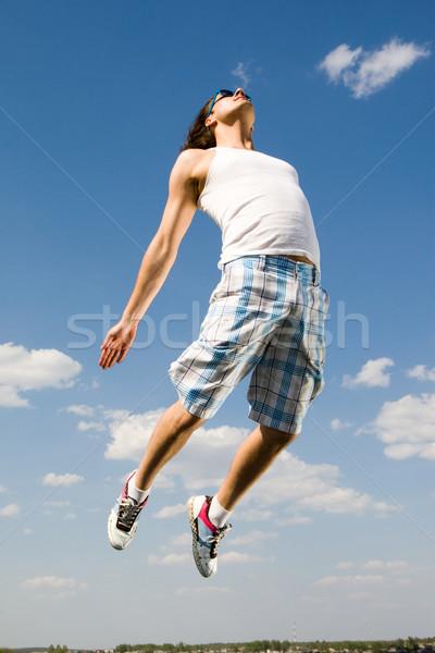ダイナミック 若者 画像 エネルギッシュな 男 ジャンプ ストックフォト © pressmaster