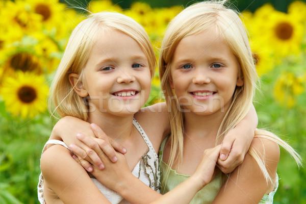 Hugging sisters Stock photo © pressmaster