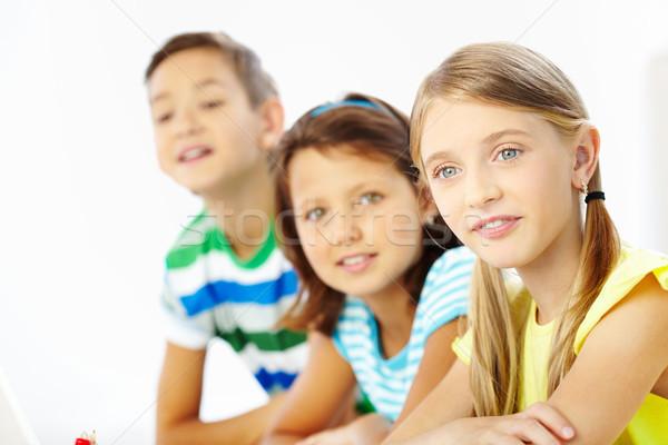Attentif écolière portrait fille écouter enseignants Photo stock © pressmaster