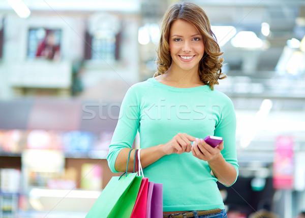 Texting shopper Stock photo © pressmaster