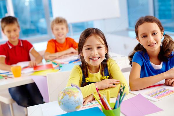 Osztálytársak portré ül gyerekek gyerekek asztal Stock fotó © pressmaster