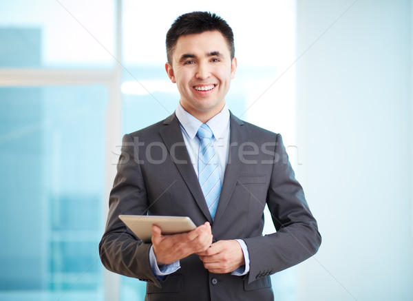 Businessman with touchpad Stock photo © pressmaster