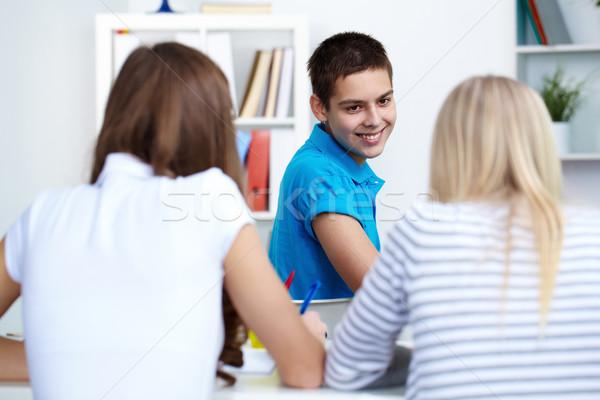 Feliz chico mirando lección Foto stock © pressmaster
