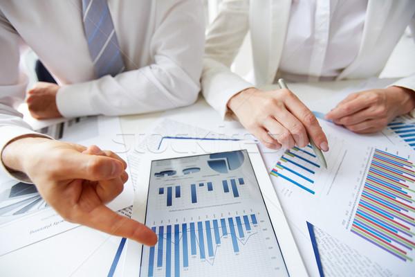 Making report on statistics Stock photo © pressmaster