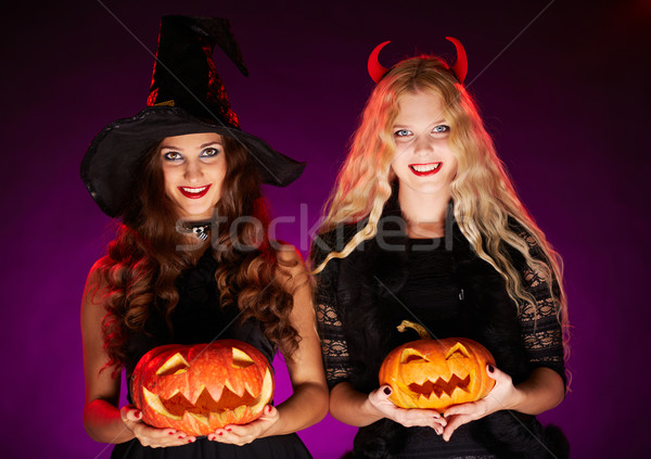 Halloween witches with pumpkins Stock photo © pressmaster