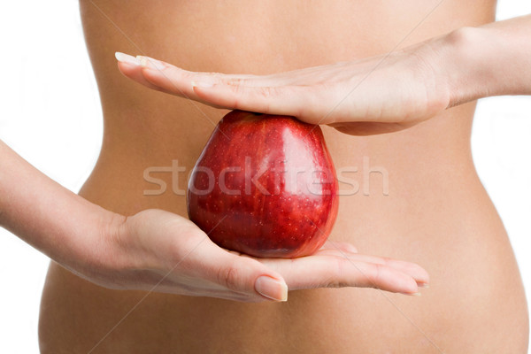 Stock photo: Apple between hands