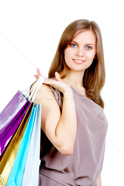 Szczęśliwy kobiet zakupy patrząc kamery Zdjęcia stock © pressmaster