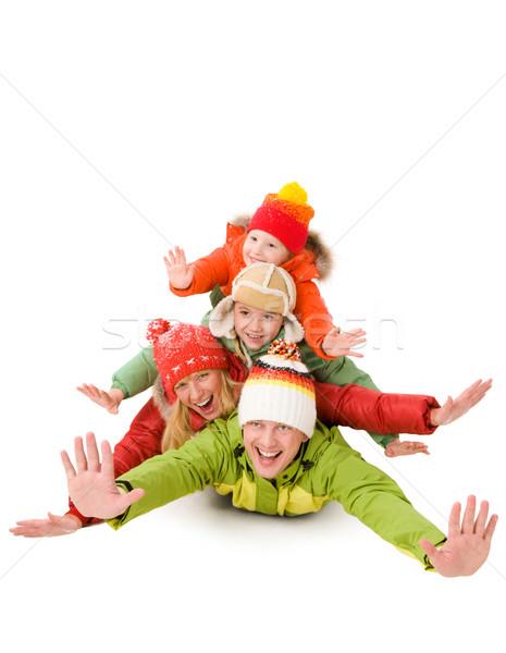 Podniecenie szczęśliwą rodzinę śmiechem broni rodziny Zdjęcia stock © pressmaster