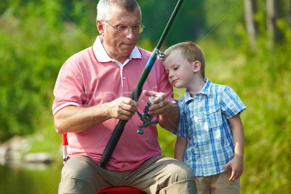Hobby foto abuelo nieto pesca fin de semana Foto stock © pressmaster