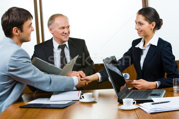 бизнеса консенсус фото Бизнес-партнеры , держась за руки Сток-фото © pressmaster