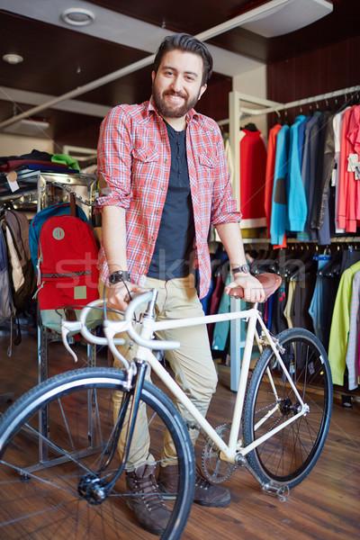 велосипедов продавец портрет красивый мужчина велосипед глядя Сток-фото © pressmaster