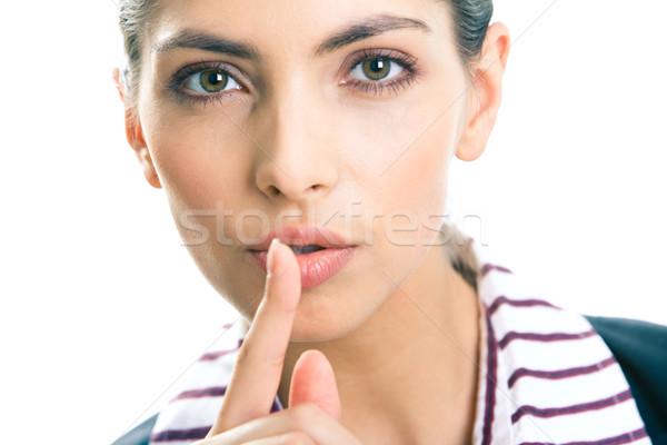 Gesto retrato jovem mulher de negócios dedo lábios Foto stock © pressmaster