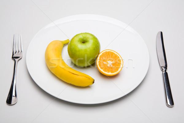 Gyümölcs mix fotó néhány gyümölcsök porcelán tányér Stock fotó © pressmaster