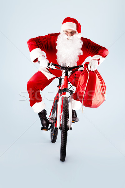 Santa on bicycle Stock photo © pressmaster