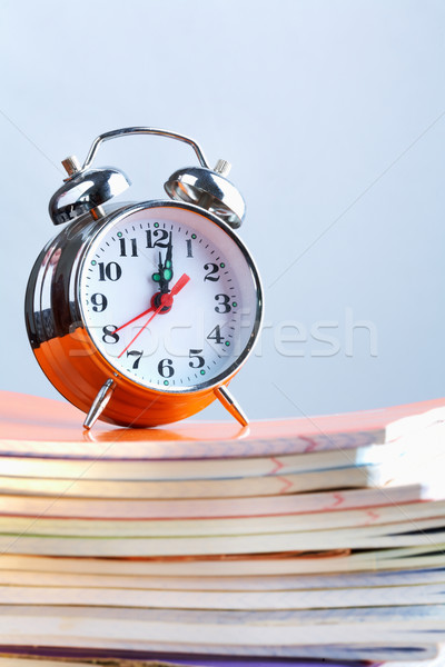 Clock and copybooks Stock photo © pressmaster