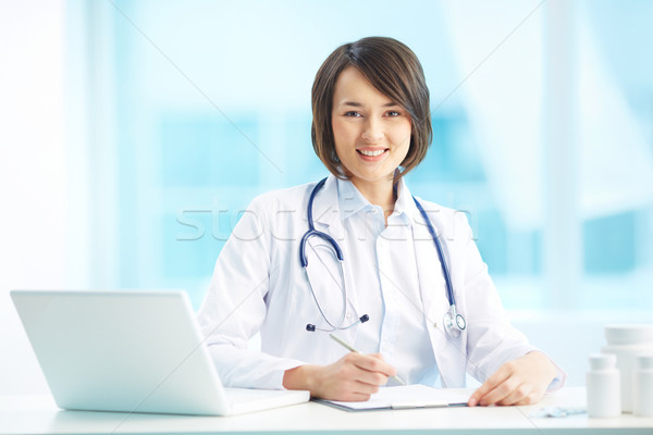 Physician at workplace Stock photo © pressmaster