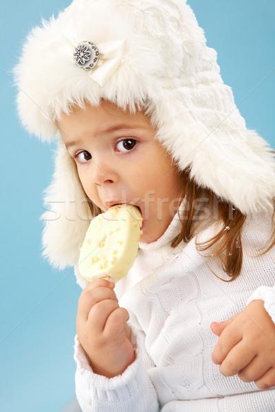 Cuki kislány fehér szőrös kalap néz Stock fotó © pressmaster