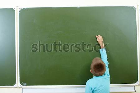 Lad by the blackboard Stock photo © pressmaster