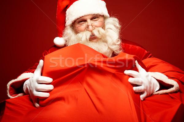 Nagylelkűség portré mikulás átkarol hatalmas piros Stock fotó © pressmaster