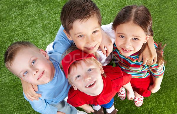 Derűs haverok mosolyog gyerekek idő együtt Stock fotó © pressmaster