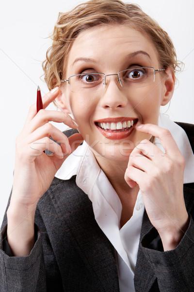 Kellemes meglepetés kép meglepődött üzletasszony szemüveg Stock fotó © pressmaster