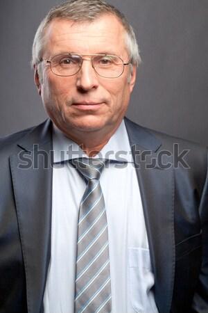 Dojrzały pracodawca Fotografia starszy patrząc kamery Zdjęcia stock © pressmaster