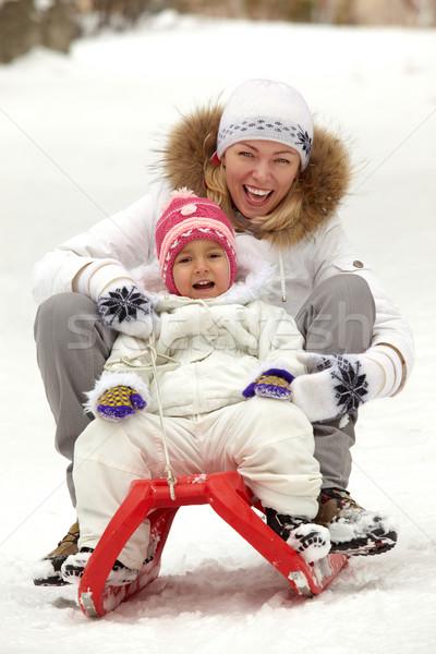 Stock fotó: Lány · anya · boldog · lány · nő · ül · szánkó