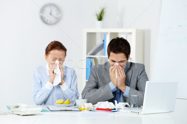 Sick co-workers Stock photo © pressmaster