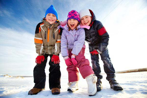 örvend gyerekek örömteli néz kamera boldog Stock fotó © pressmaster
