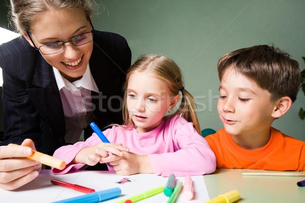 Leraar afbeelding glimlachend markeerstift naar Stockfoto © pressmaster