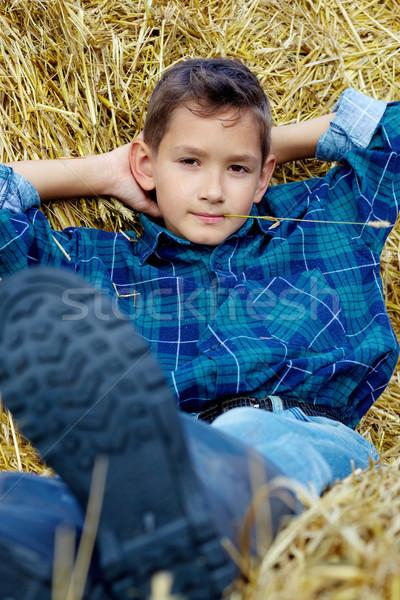 Boy with straw Stock photo © pressmaster