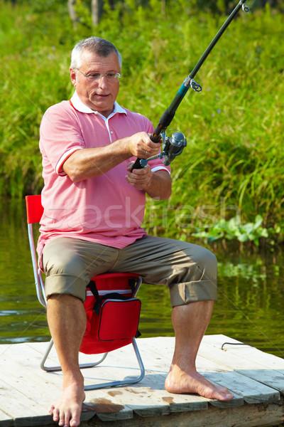 Balıkçı fotoğraf kıdemli adam balık tutma hafta sonu Stok fotoğraf © pressmaster