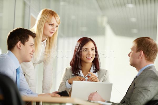 Interessante idéia pessoas de negócios olhando masculino colega Foto stock © pressmaster
