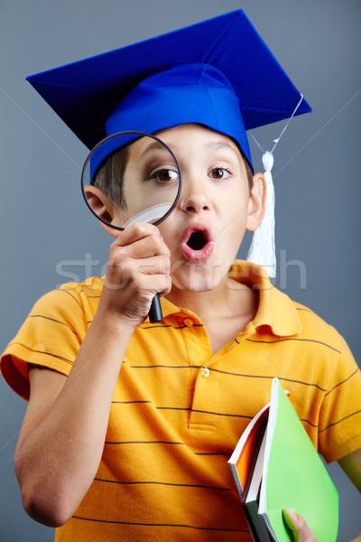 Inteligente detetive retrato curioso menino graduação Foto stock © pressmaster