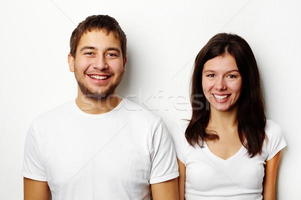 Couple in white T-shirts Stock photo © pressmaster