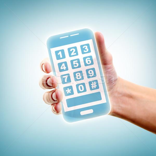 Holding smartphone Stock photo © pressmaster