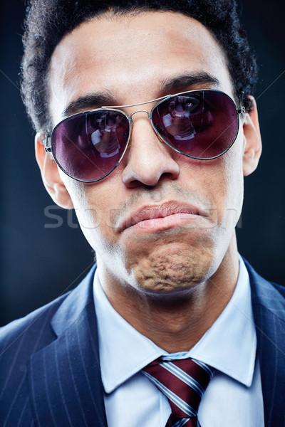 портрет сомнительный человека Солнцезащитные очки глядя Сток-фото © pressmaster