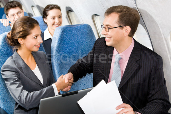 Handshake in a plane  Stock photo © pressmaster