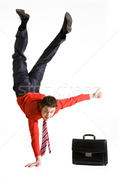 Photo of isolated young man showing sign of okay while keeping on right arm Stock photo © pressmaster