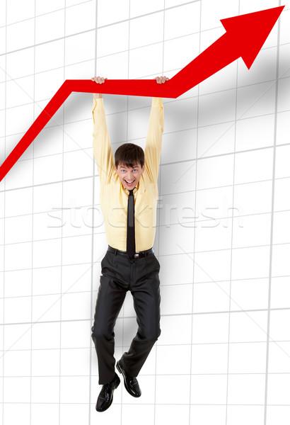 Finansów wesoły człowiek wiszący finansowych graficzne Zdjęcia stock © pressmaster