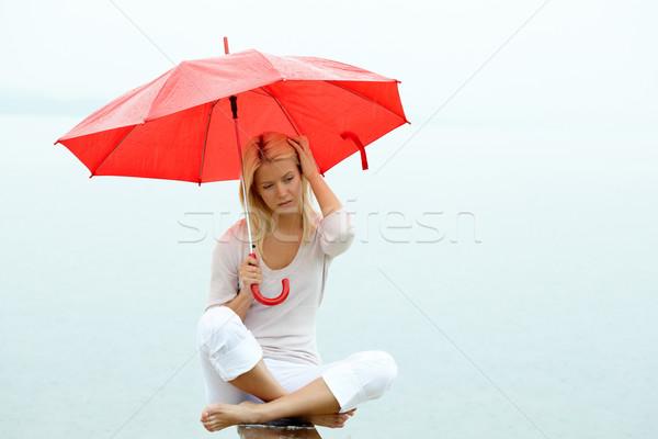 Tristesse portrait triste jeune femme séance parapluie Photo stock © pressmaster
