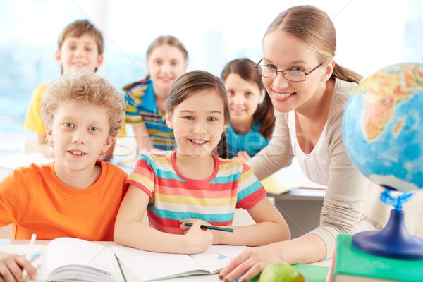 Pupils and teacher Stock photo © pressmaster