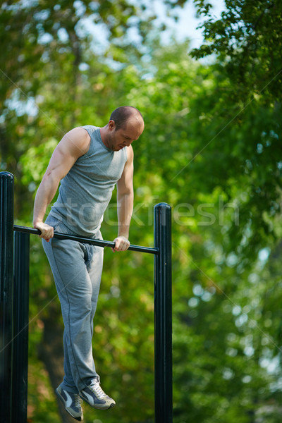 Exercising on sport facilities Stock photo © pressmaster